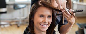 Woman getting her hair cut